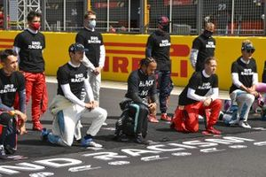 Lewis Hamilton, Mercedes-AMG F1, and the other drivers stand and take a knee to show their support for the End Racism campaign