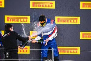 Race winner Alexander Smolyar, ART Grand Prix celebrates on the podium with the chmapagne