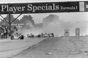 Emerson Fittipaldi, Lotus 72E Ford as Jody Scheckter, McLaren M23 Ford causes a huge collision behind