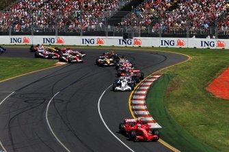 Kimi Raikkonen, Ferrari F2007 leads at the start of the race