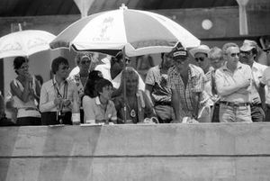 Rod Stewart, Rock Star, is on the Brabham pit wall alongside Herbie Blash, Brabham Team Manager and Bernie Ecclestone, Brabham Team Owner