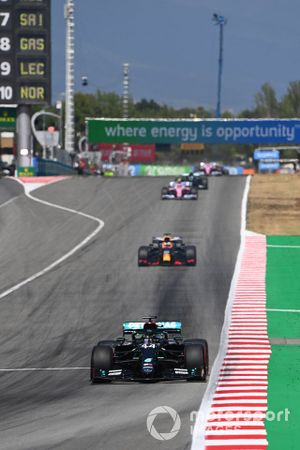 Lewis Hamilton, Mercedes F1 W11 EQ Performance, leads Max Verstappen, Red Bull Racing RB16, and Lance Stroll, Racing Point RP20