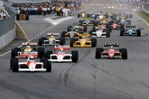 Alain Prost, McLaren MP4-4 leads at the start of the race