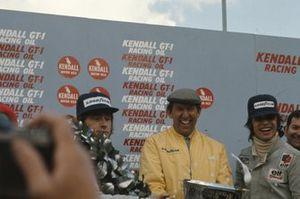 Podium: Ken Tyrrell celebrates with his drivers Race winner Jackie Stewart and François Cevert, Tyrrell