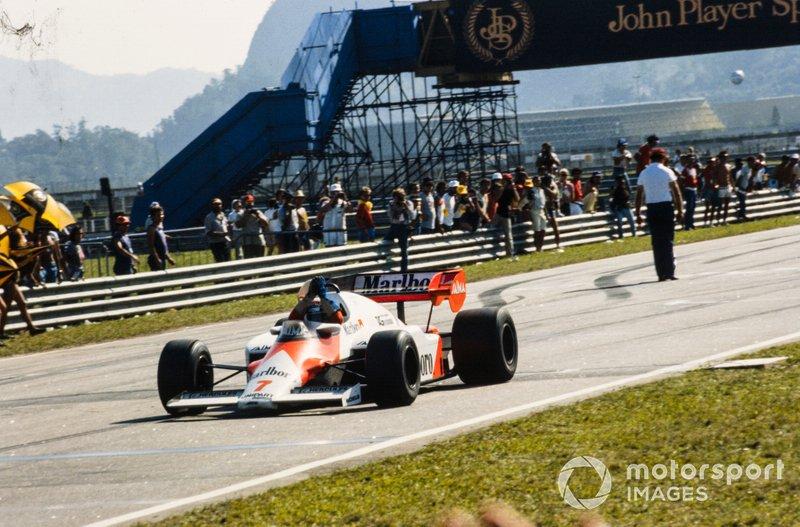 Alain Prost, McLaren MP4-2 TAG, celebrates victory