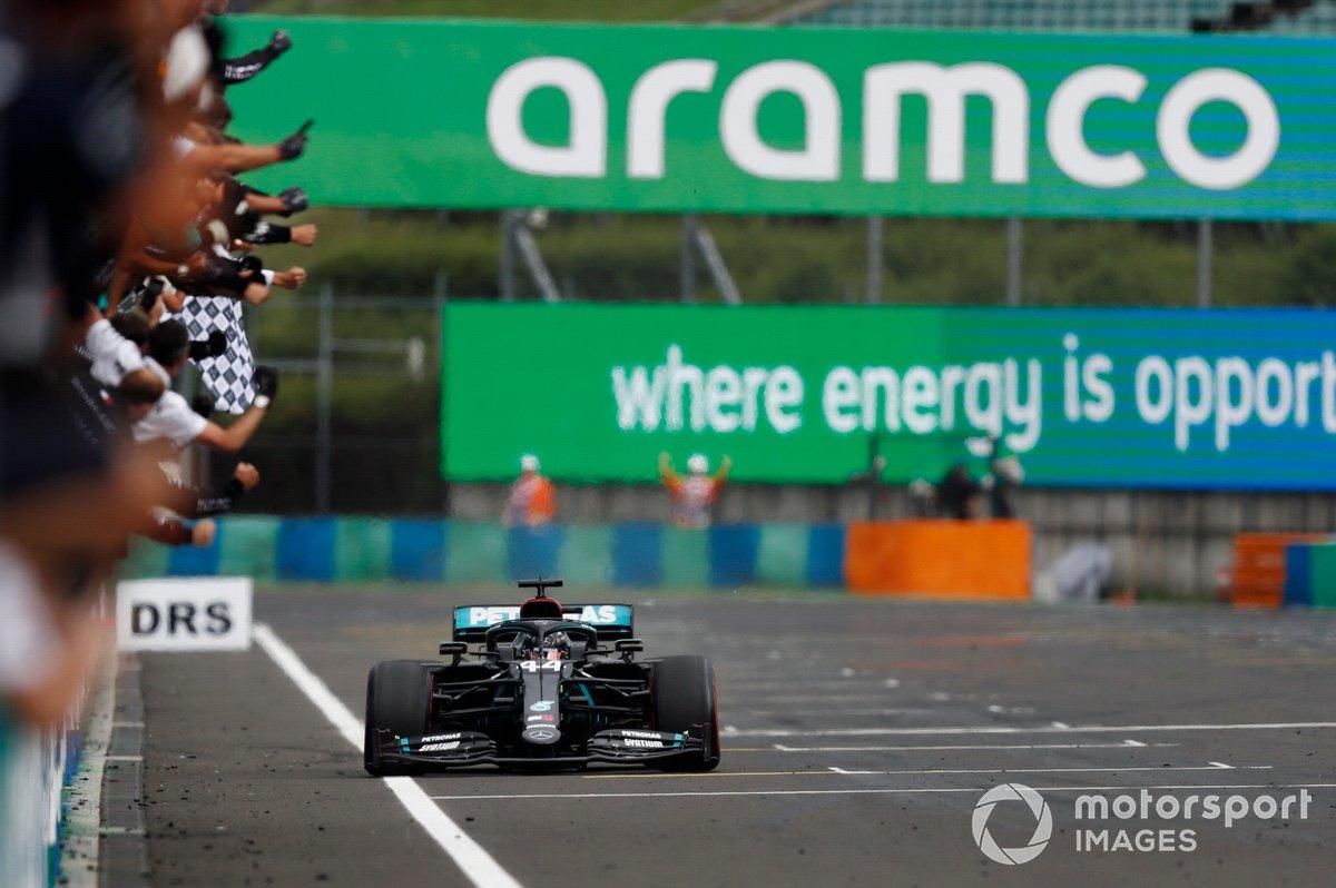 Lewis Hamilton, Mercedes F1 W11, takes the chequered flag