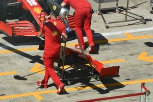 Ferrari mechanics push the car of Charles Leclerc, Ferrari SF1000 in the pit lane
