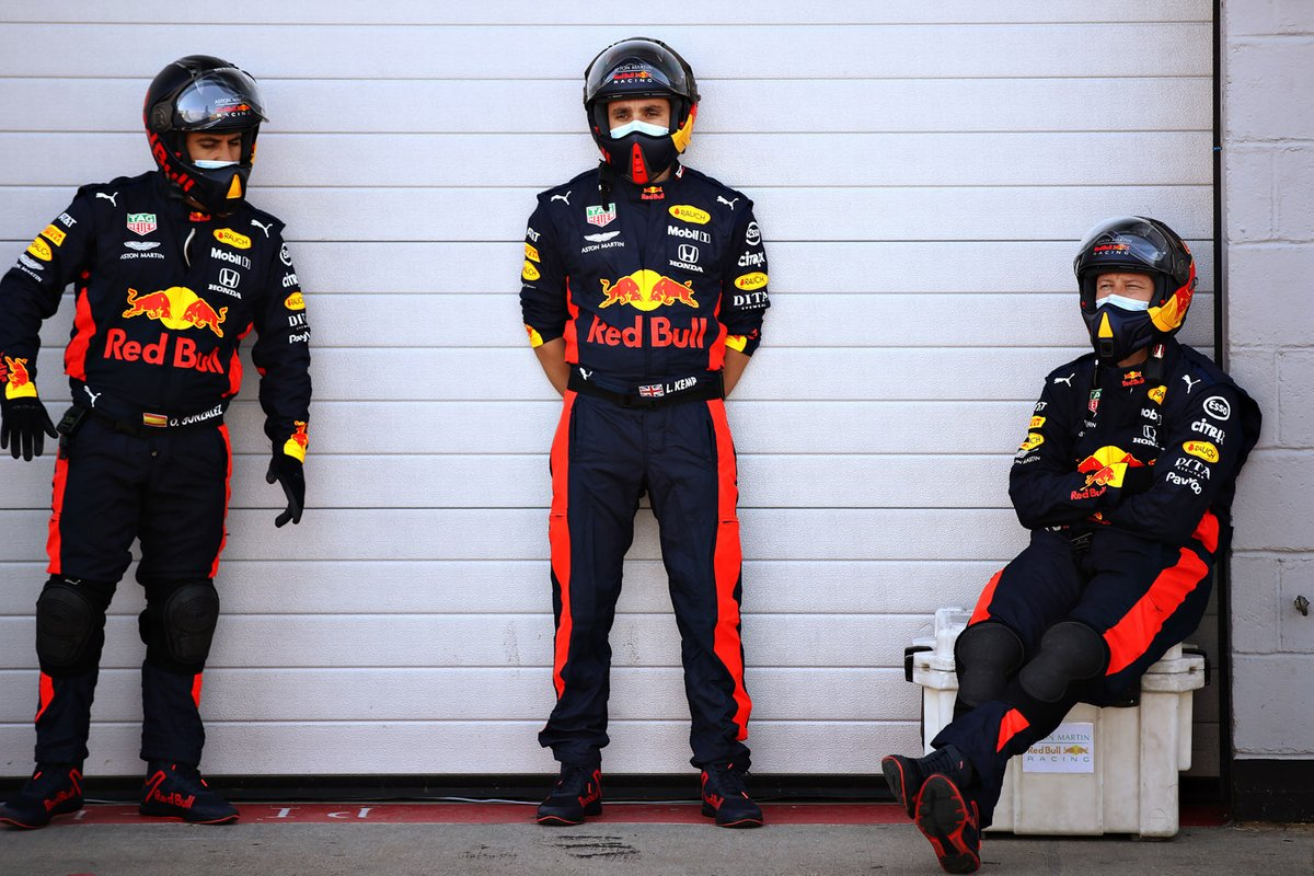 Red Bull Racing team members in the pitlane