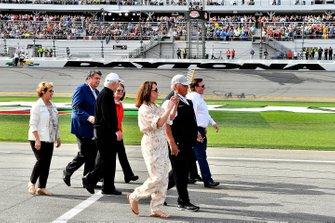 Rick Hendrick, Roger Penske, and Mike Helton walk down pit road
