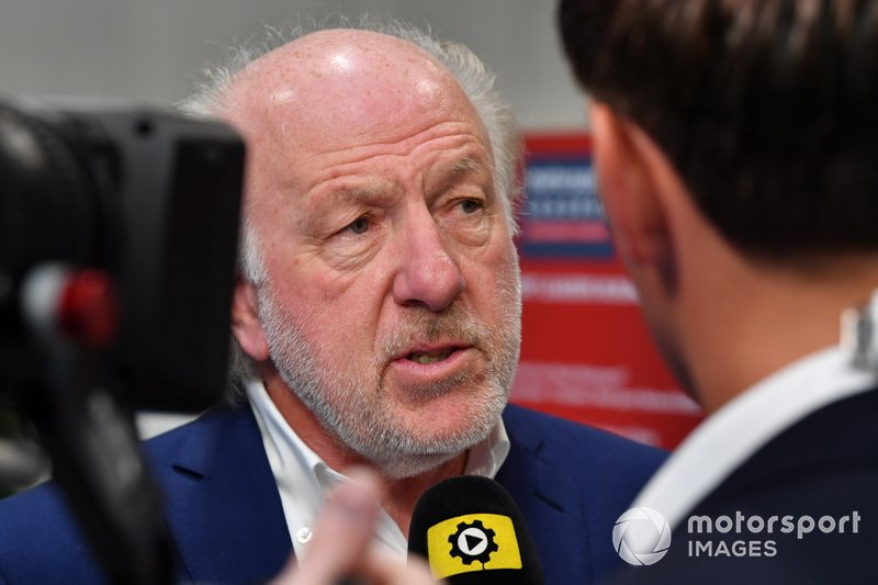 David Richards, chairman of Motorsport UK, talks to the press