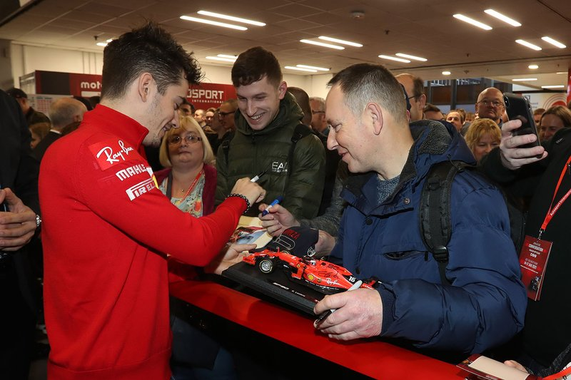 Charles Leclerc, Ferrari signs autographs for fans before opening Autosport International 2020