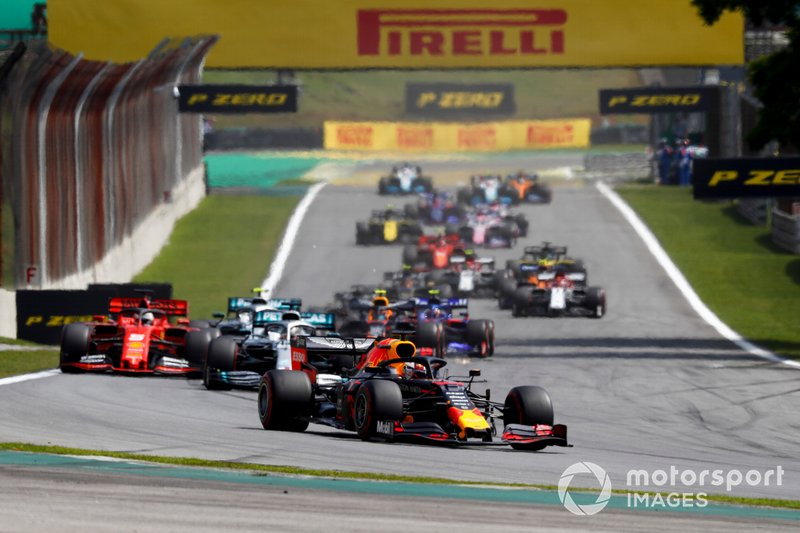 Max Verstappen, Red Bull Racing RB15 leads Lewis Hamilton, Mercedes AMG F1 W10 and Sebastian Vettel, Ferrari SF90 at the start of the race