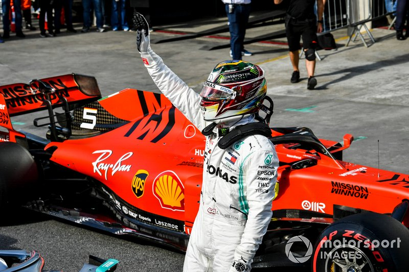 Lewis Hamilton, Mercedes AMG F1, gives fans a wave after Qualifying