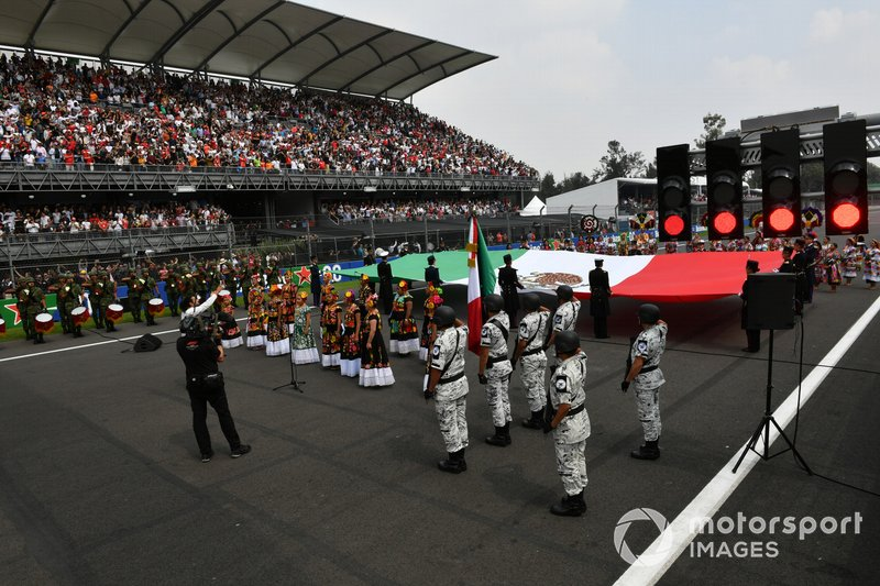 The national anthem is performed during the pre race grid celebrations