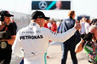 Valtteri Bottas, Mercedes AMG F1, celebrates after taking Pole Position