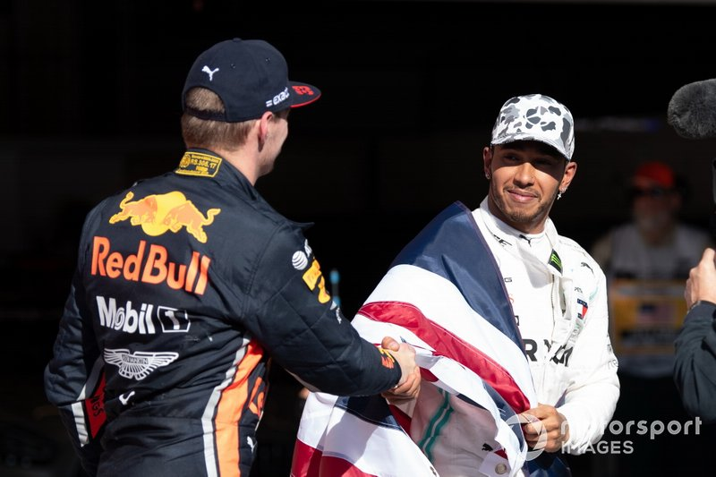 Max Verstappen, Red Bull Racing, 3rd position, congratulates Lewis Hamilton, Mercedes AMG F1, 2nd position, on securing his sixth world drivers championship title
