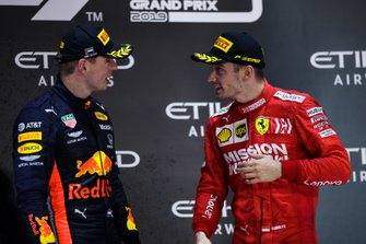 Max Verstappen, Red Bull Racing, 2nd position, and Charles Leclerc, Ferrari, 3rd position, talk on the podium