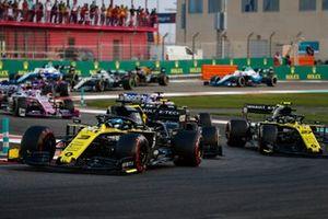 Daniel Ricciardo, Renault F1 Team R.S.19, leads Kevin Magnussen, Haas F1 Team VF-19, and Nico Hulkenberg, Renault F1 Team R.S. 19