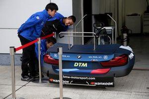 Japanese Team member looking on car parts of Alex Zanardi, BMW Team RBM BMW M4 DTM