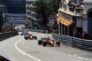 Jean Alesi, Ferrari 412T2, leads Gerhard Berger, Ferrari 412T2, and Johnny Herbert, Benetton B195 Renault