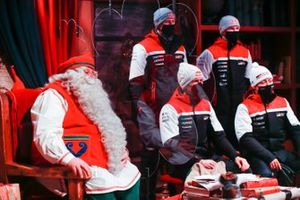 Sebastien Ogier, Elfyn Evans, Kalle Rovanpera and Takamoto Katsuta of Toyota Gazoo Racing are seen with Santa Claus