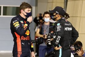 Max Verstappen, Red Bull Racing, 2nd position, and Lewis Hamilton, Mercedes-AMG F1, 1st position, in Parc Ferme