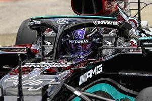 Lewis Hamilton, Mercedes, arrives in Parc Ferme after securing pole