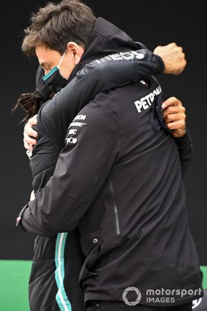 Toto Wolff, Executive Director (Business), Mercedes AMG, and Lewis Hamilton, Mercedes-AMG F1, 1st position, in Parc Ferme after securing a seventh world championship title