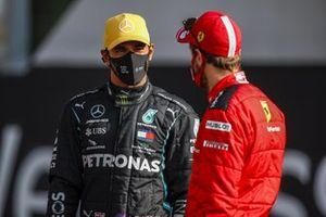 Lewis Hamilton, Mercedes-AMG F1, chats with Sebastian Vettel, Ferrari