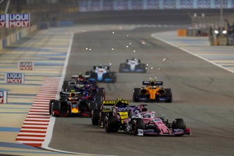 Sergio Perez, Racing Point RP19, leads Nico Hulkenberg, Renault R.S. 19, Pierre Gasly, Red Bull Racing RB15, and Alexander Albon, Toro Rosso STR14