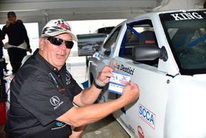 Jim Dentici applies the original 1988 SCCA Runoffs tech-inspection sticker to the restored 1988 Acura Integra.