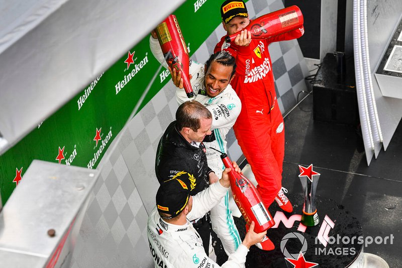 Valtteri Bottas, Mercedes AMG F1, 2nd position, Lewis Hamilton, Mercedes AMG F1, 1st position, and Sebastian Vettel, Ferrari, 3rd position, on the podium