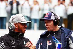 (L to R): Lewis Hamilton, Mercedes AMG F1 with Daniil Kvyat, Scuderia Toro Rosso on the drivers parade