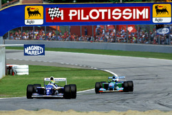 Ayrton Senna, Williams FW16, leads Michael Schumacher, Benetton B194