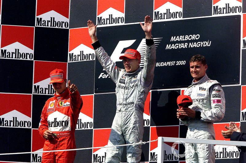 Podyum: Yarış galibi Mika Hakkinen, McLaren, 2. Michael Schumacher, Ferrari, 3. David Coulthard, McL