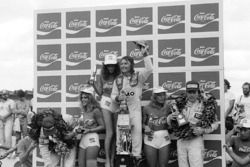 Podium: second place Elio de Angelis, Lotus, Race winner Rene Arnoux, Renault, third place Alan Jones, Williams