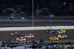 Kurt Busch, Stewart-Haas Racing Ford passes Kyle Larson, Chip Ganassi Racing Chevrolet for the win