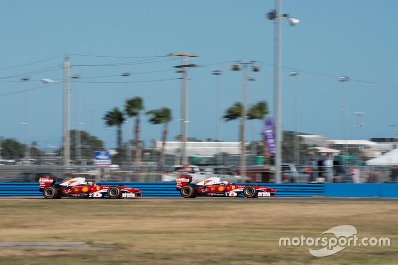 Sebastian Vettel, Ferrari F60; Kimi Raikkonen, Ferrari F60
