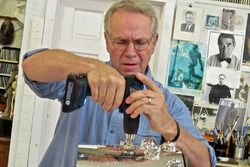 Sculptor Will Behrends drills into the base of the Borg-Warner Trophy in preparation to add 2016 Ind