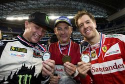 Petter Solberg, Tom Kristensen and Sebastian Vettel, with their medals