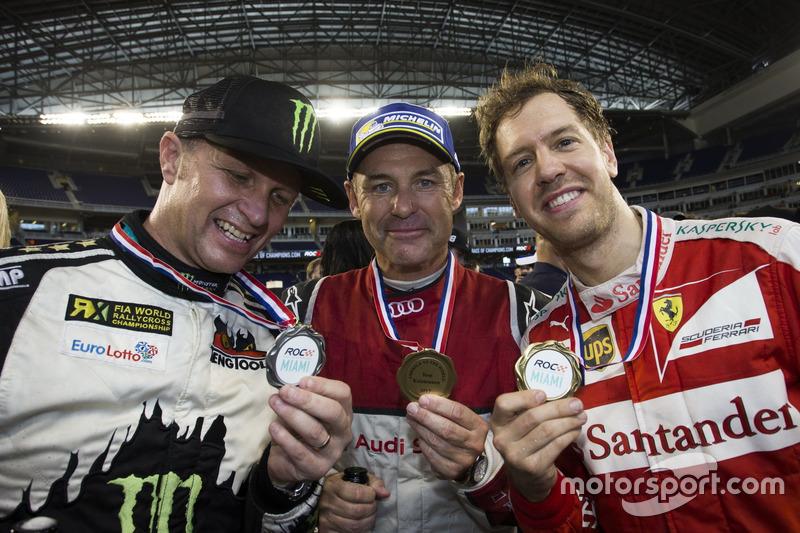 Petter Solberg, Tom Kristensen and Sebastian Vettel, with their medals