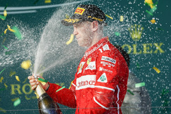 Sebastian Vettel, Ferrari, 1st Position, blasts himself with Champagne on the podium
