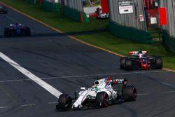 Felipe Massa, Williams FW40, leads Romain Grosjean, Haas F1 Team VF-17