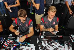 Romain Grosjean, Haas F1 Team and Kevin Magnussen, Haas F1 Team signs autograph for the fans