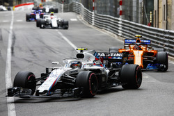 Sergey Sirotkin, Williams FW41, leads Stoffel Vandoorne, McLaren MCL33, and Charles Leclerc, Sauber C37