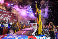 Kyle Busch, Joe Gibbs Racing, Toyota Camry M&M's Red White & Blue, celebrates in victory lane after winning in Charlotte