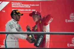Lewis Hamilton, Mercedes-AMG F1 and Kimi Raikkonen, Ferrari celebrate on the podium