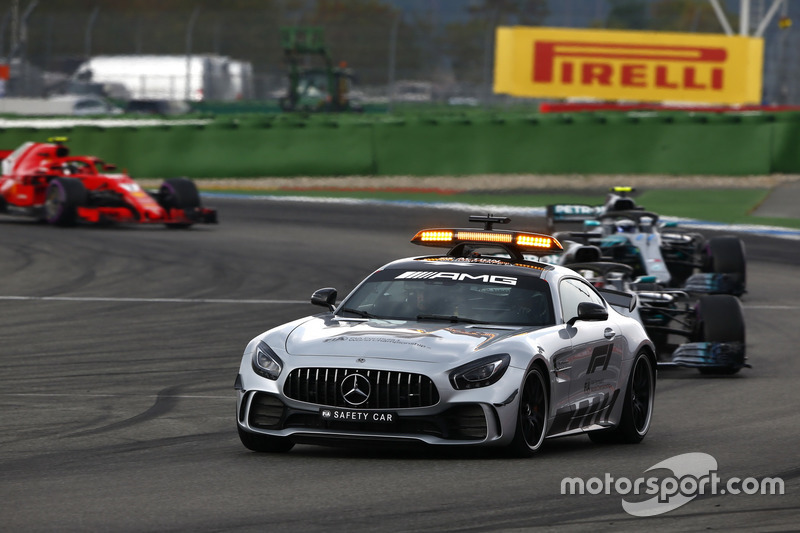 The safety car leads Lewis Hamilton, Mercedes AMG F1 W09, Valtteri Bottas, Mercedes AMG F1 W09 and Kimi Raikkonen, Ferrari SF71H