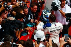 Valtteri Bottas, Mercedes AMG F1, 2nd position, and Lewis Hamilton, Mercedes AMG F1, 1st position, celebrate in Parc Ferme