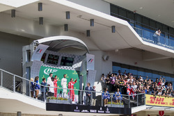 Race winner Lewis Hamilton, Mercedes AMG F1 celebrates on the podium alongside James Allison, Merced